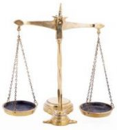 Balance scales symbol of justice on white backround with reflection